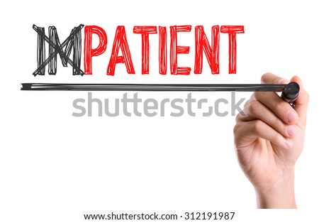 Hand with marker writing the word Impatient/Patient ...