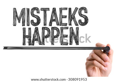 Hand with marker writing the word Mistaeks Happen - stock photo