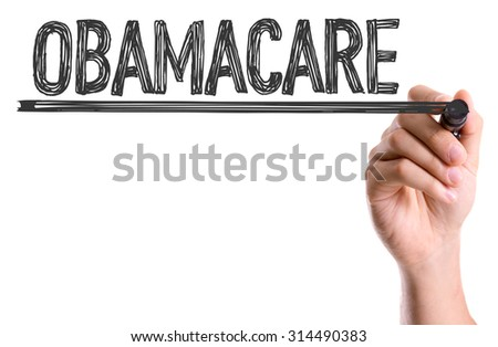 Hand with marker writing the word Obamacare - stock photo