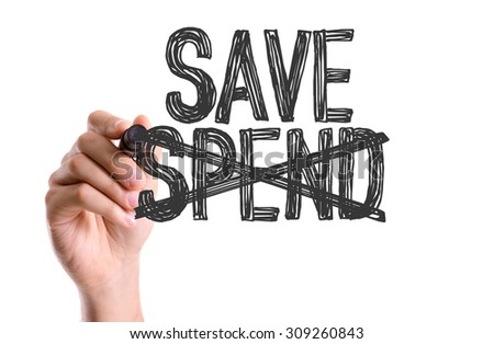 Hand with marker writing the word Save Spend - stock photo