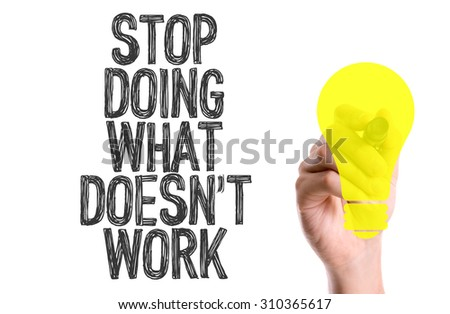 Hand with marker writing the word Stop Doing What Doesn't Work - stock photo