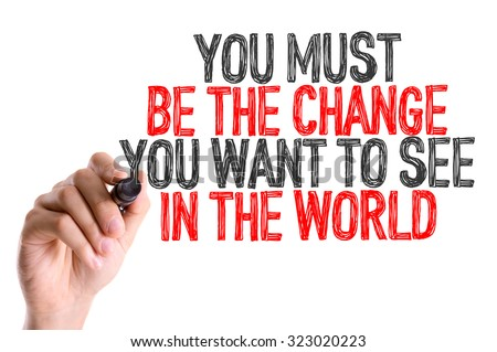 Hand with marker writing: You Must Be The Change You Want to See in the World - stock photo