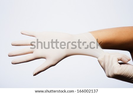 hand with medical gloves on white - stock photo