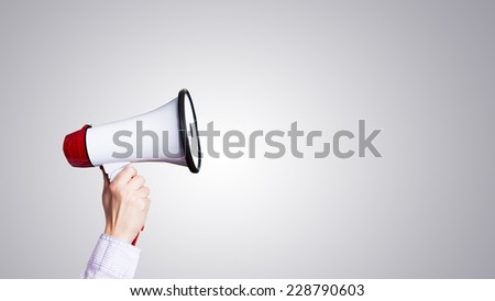 hand with megaphone - stock photo