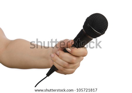 Hand with microphone on white - stock photo