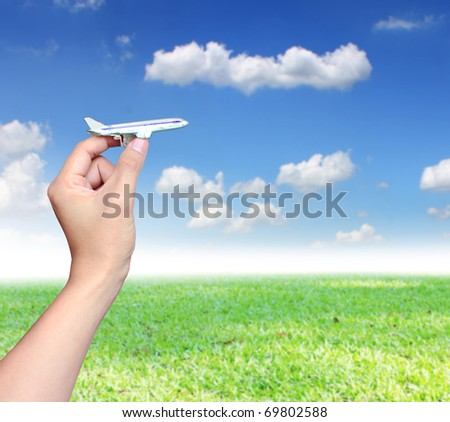 HAND with model aircraft - stock photo