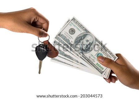 Hand with money and car keys, Isolated over white - stock photo
