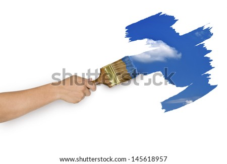 Hand with paintbrush painting sky isolated on white background - stock photo