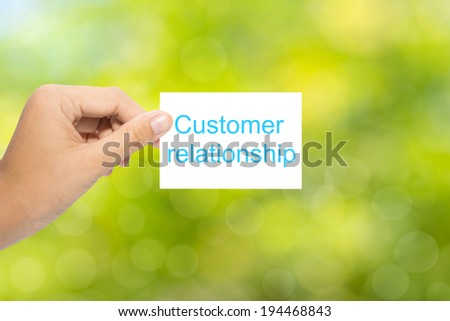 Hand with paper customer relationship  - stock photo