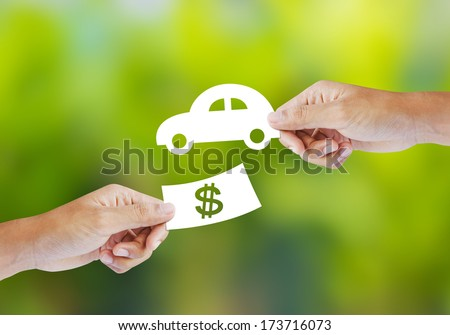 Hand with paper money and car shape. new car buy concept - stock photo