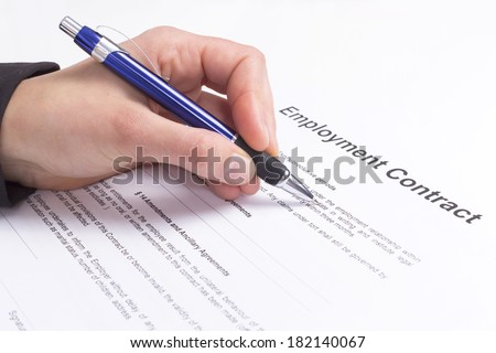 Hand with pen and employment contract - stock photo