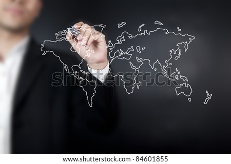 Hand with pen drawing a world map in whiteboard - stock photo