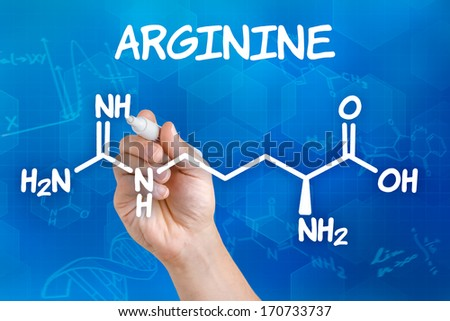 Hand with pen drawing the chemical formula of arginine - stock photo