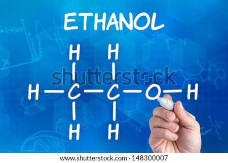 hand with pen drawing the chemical formula of ethanol - stock photo