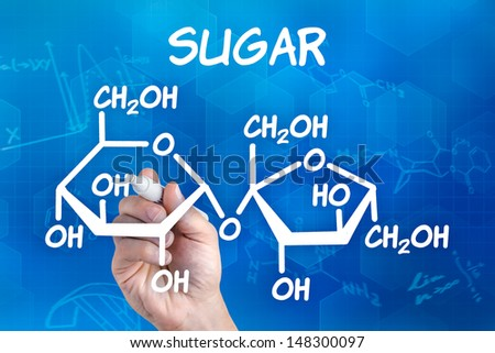 hand with pen drawing the chemical formula of sugar - stock photo