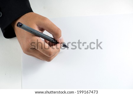 Hand with pen on white background - stock photo