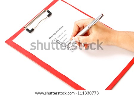 Hand with pen over blank check boxes in beverage question form - stock photo