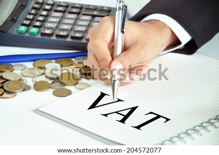 Hand with pen pointing to VAT (or Value Added Tax) sign on the paper - commercial & taxation concept - stock photo