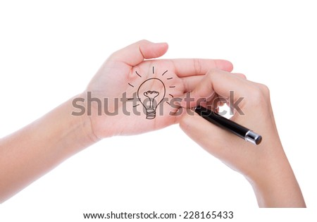 Hand with pen write idea light bulb  isolated on white background - stock photo