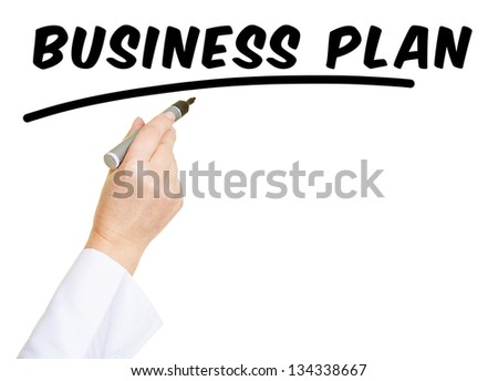 Hand with pen writing the word Business Plan - stock photo