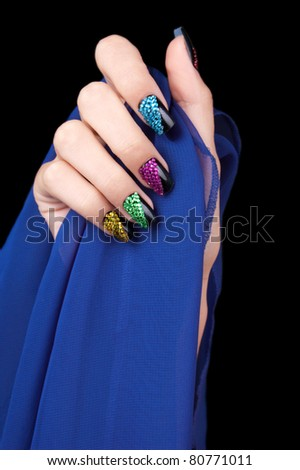 Hand with perfect sparkling colourful manicure - stock photo