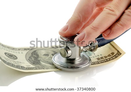 hand with phonendoscope and hundred dollars note - stock photo