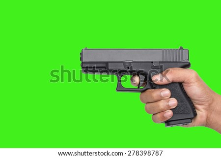 Hand with pistol on green screen background - stock photo