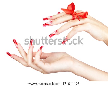 Hand with red french acrylic nails manicure and paiting with bow on finger isolated  white background - stock photo