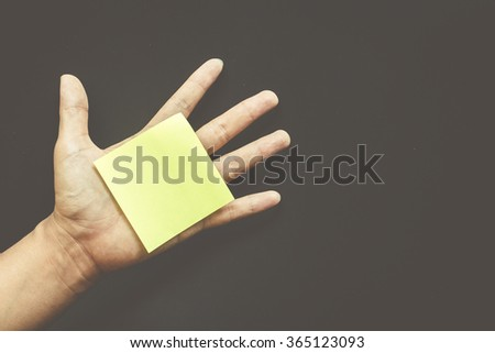 Hand with reminder sticky note ,empty space for text - stock photo