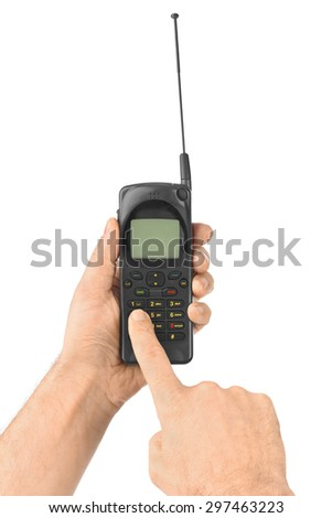 Hand with retro mobile phone isolated on white background - stock photo