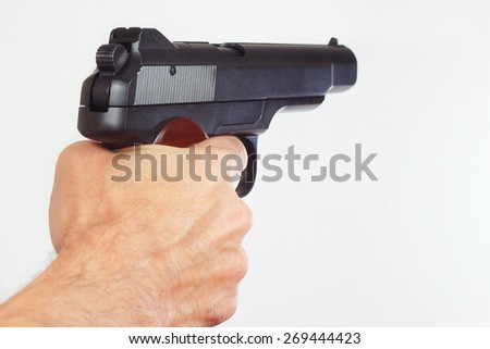 Hand with semi-automatic handgun close up - stock photo