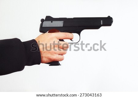 Hand with semi-automatic pistol on a white background - stock photo