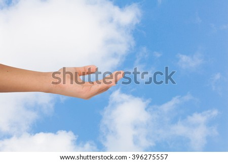 Hand with sky, business concept - stock photo