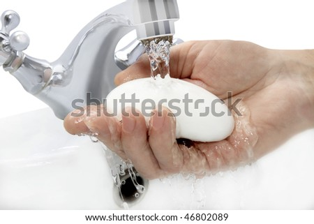 hand with soap under running water - stock photo