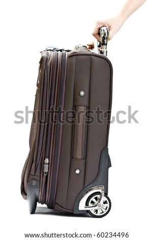 hand with suitcase - stock photo
