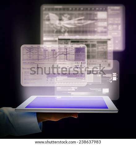 Hand with tablet computer. web technology abstract background - stock photo