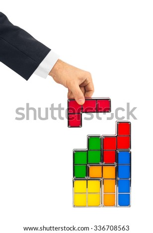 Hand with tetris toy blocks isolated on white background - stock photo
