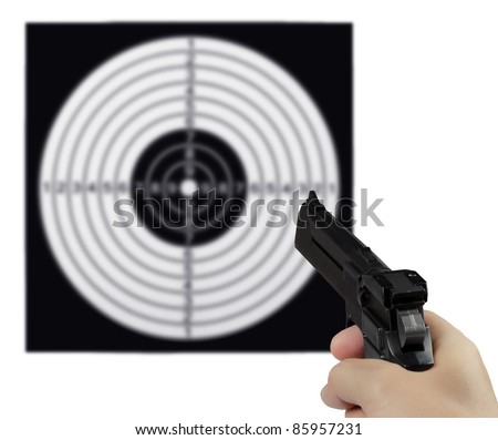 Hand with the gun against the shooting target - stock photo