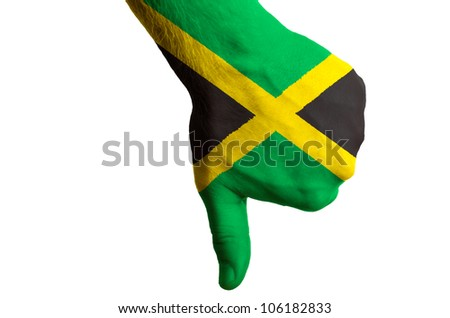 Hand with thumb down gesture in colored jamaica national flag as symbol of negative political, cultural, social management of country - stock photo