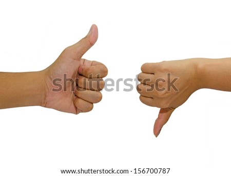 Hand with thumb up and down isolated on white background. - stock photo
