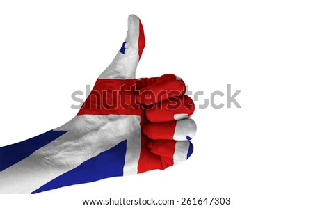 Hand with thumb up gesture in colored United Kingdom national flag isolated on white background. - stock photo