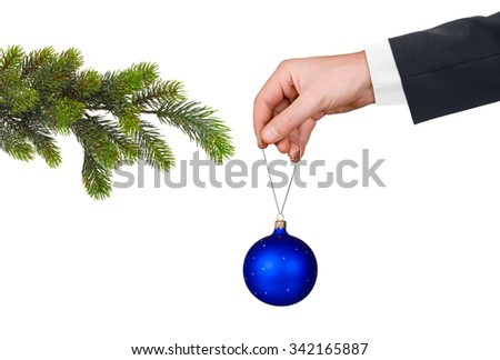 Hand with toy and Christmas tree isolated on white background - stock photo