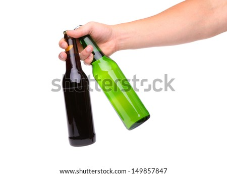 Hand with two bottle of beer - stock photo
