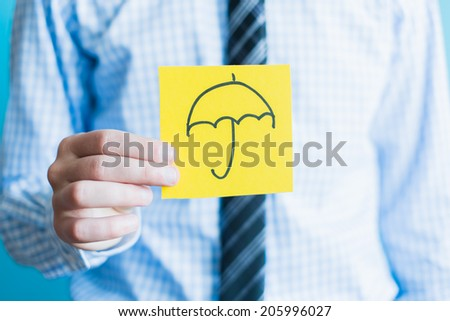 Hand with umbrella  icon - stock photo