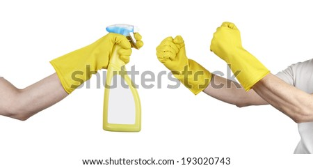 hand with yellow cleaning product glove in fight - stock photo
