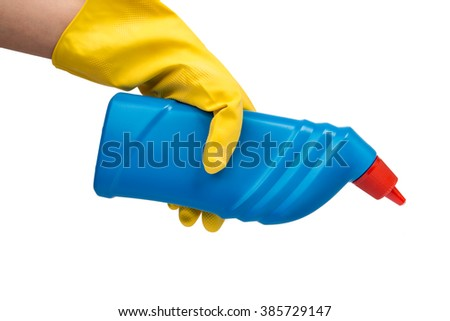 Hand with yellow glove holding cleaning product - stock photo