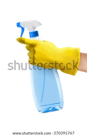 Hand with yellow rubber cleaning glove holding a spray bottle. Isolated on a white background. - stock photo