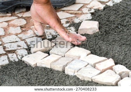 hand worker while system stones of a floor - stock photo