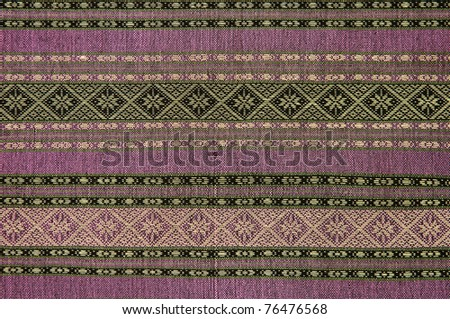 Hand-woven fabrics in Thai-pattern designs. - stock photo