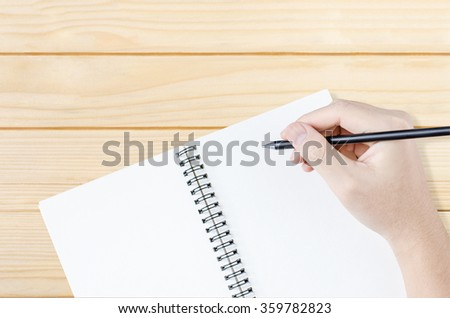 Hand write on the notebook - stock photo